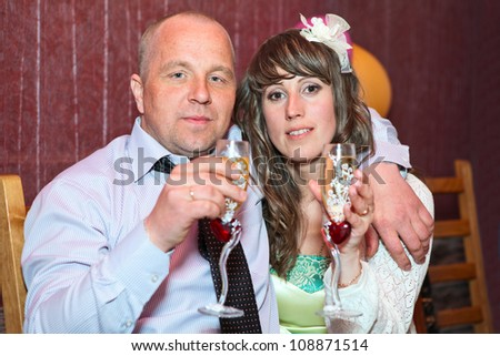 Caucasian man and woman portrait with wineglasses - stock photo