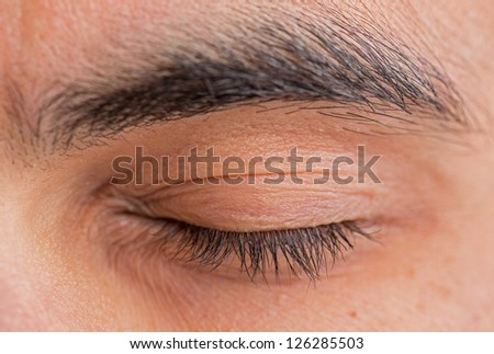 Caucasian man closed left eye and eyebrow