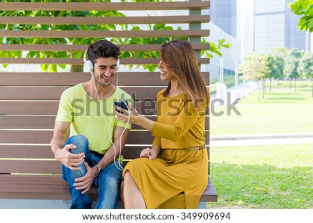 Caucasian man enjoy the music with his girlfriend - stock photo
