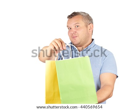 Caucasian man fat,  with colorful shopping paper bags  Isolated on white background.   - stock photo