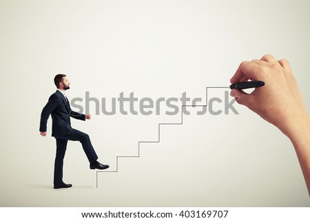 Caucasian man in a formal wear climbing drawn stairs, side view
