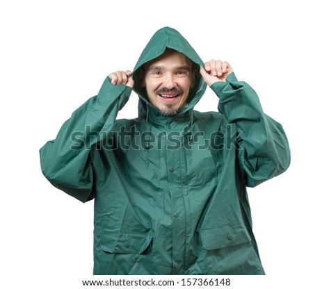 Caucasian man in a rain suit putting the hood over the head isolated on white background. - stock photo