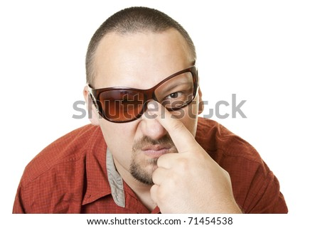 Caucasian man in red t shirt with fancy  broken glasses - stock photo