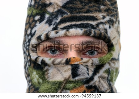caucasian man in ski mask over white