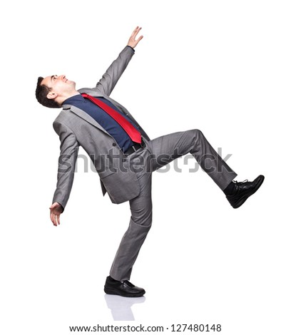 caucasian man near to fall on white background