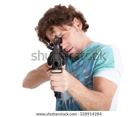 Caucasian man taking aim with a machine gun, isolated on white background
