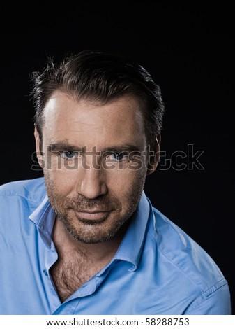 caucasian man unshaven portrait smiling cheerful isolated studio on black background - stock photo