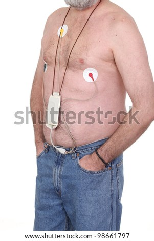 Caucasian Man Wearing Holter Monitor for heart activity