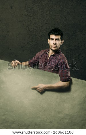 Caucasian man with banner over grey background - stock photo
