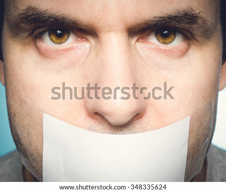 Caucasian man with duct tape on mouth, white . Conceptual image. - stock photo