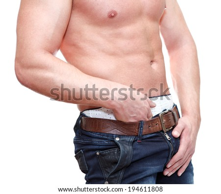 Caucasian man with naked torso holding groin isolated on white background - stock photo