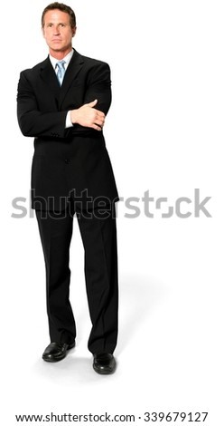 Caucasian man with short black hair in business formal outfit holding arm - Isolated