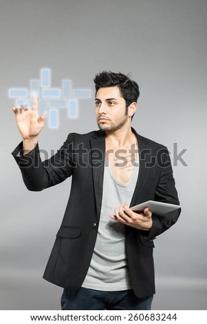 Caucasian man working with digital surface - stock photo