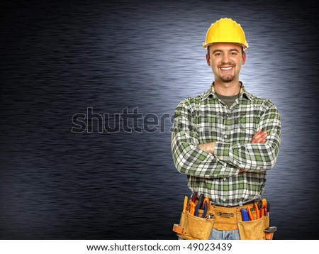 caucasian manual worker and  brushed metal background - stock photo