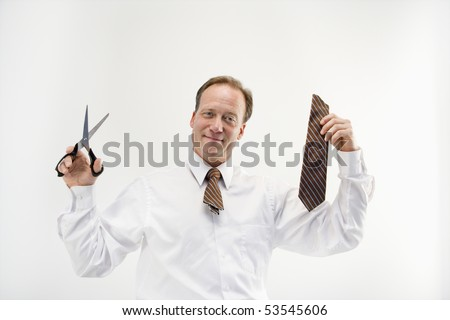 Caucasian middle aged businessman cutting off necktie with scissors.