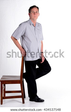 Caucasian middle aged man dressed in grey shirt  white background - stock photo