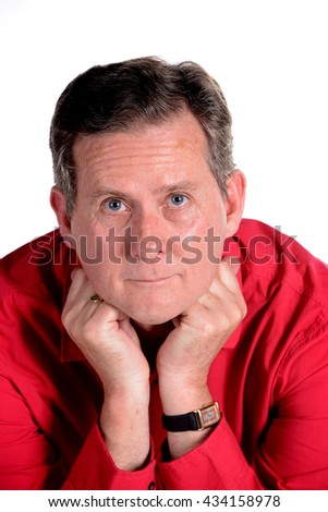Caucasian middle aged man in red shirt white background - stock photo
