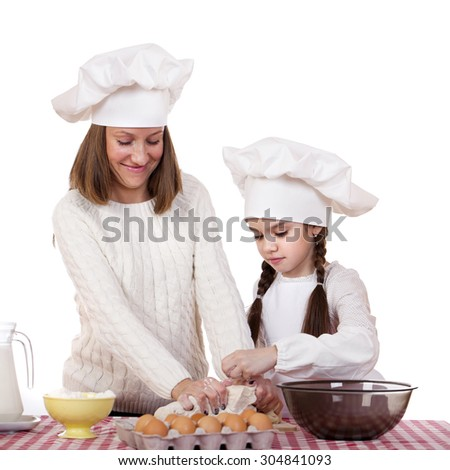 Caucasian mother and daughter preparing dough and having fun, isolated on white background