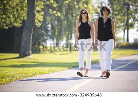 caucasian mother and daughter together in the park