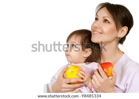 Caucasian mother with a beautiful daughter on a light background