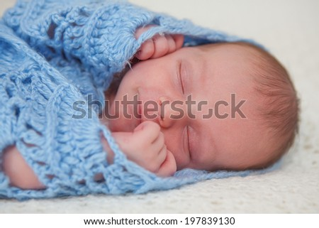 Caucasian newborn baby while sleeping closeup - stock photo