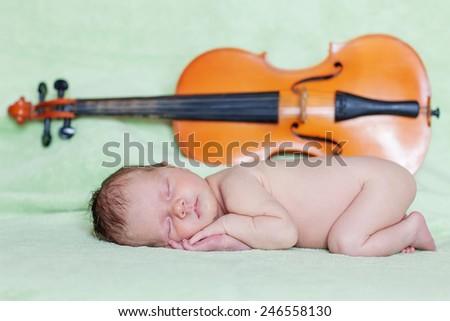 Caucasian newborn baby while sleeping closeup  - stock photo