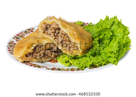 Caucasian pie stuffed with meat (cheburek) on plate, isolated