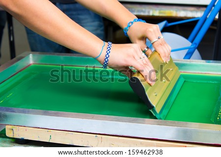 Caucasian Printer Making T-Shirt By Screen Print Technique  - stock photo