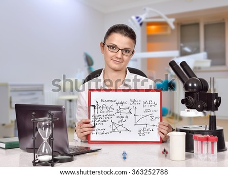 caucasian scientific researcher woman sitting in laboratory and holding clipboard with mathematic symbol - stock photo