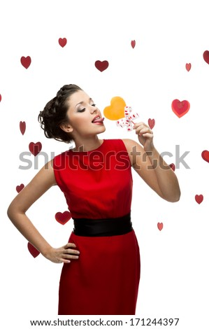 caucasian sexy stylish young woman licking lollipop. isolated on white