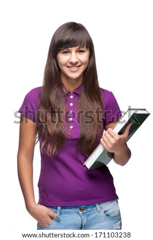 caucasian smiling girl holding book isolated on white