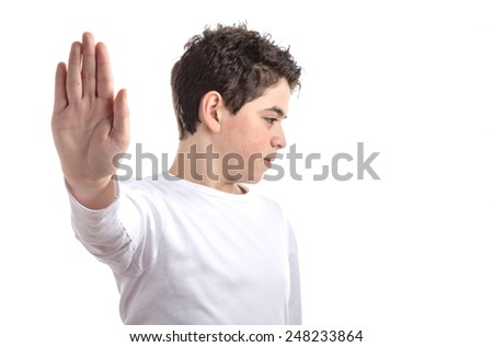 Caucasian smooth-skinned teen in a white long sleeve t-shirt smiles making Talk to the hand gesture with right hand - stock photo