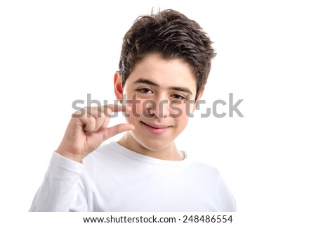 Caucasian smooth-skinned teen in a white long sleeved t-shirt making a little bit gesture - stock photo