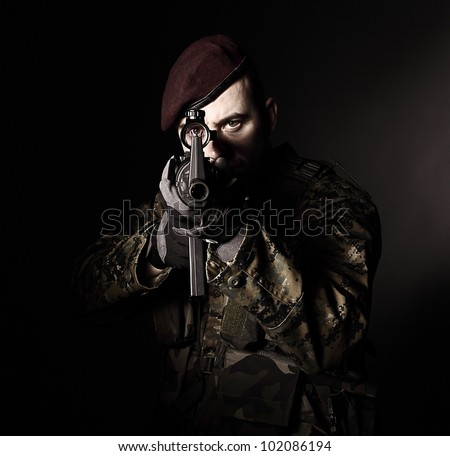 caucasian soldier portrait with rifle - stock photo