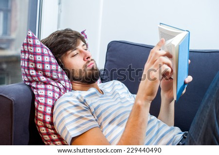 Caucasian student man reading a book. - stock photo