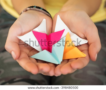 Caucasian teenage girl holding paper airplanes. - stock photo