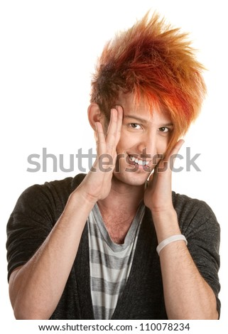 Caucasian teenage male with hands on side of face - stock photo