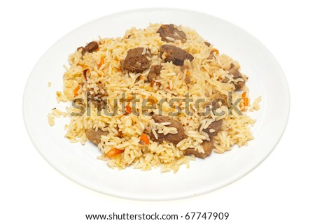 Caucasian traditional pilaf. Rice with meat - stock photo