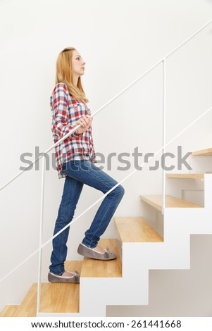 Caucasian woman ascending stairs