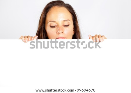 caucasian woman behind and looking down at white board - stock photo