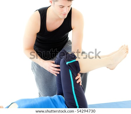 Caucasian woman exercising assited by her personal trainer in a health club - stock photo
