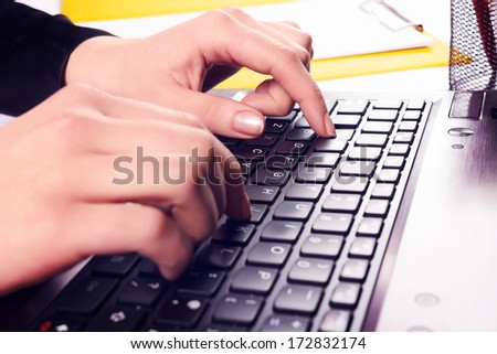 Caucasian woman hands typing on laptop keyboard - stock photo