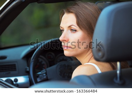Caucasian woman in a cabriolet car