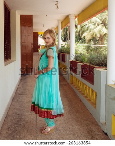 Caucasian woman in traditional indian dress - stock photo