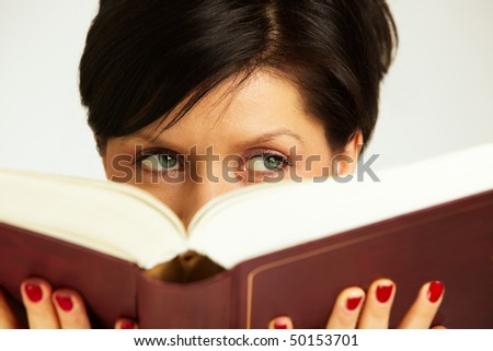 caucasian woman is holding book and thinking