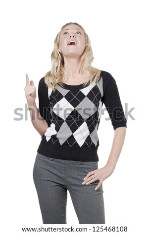 Caucasian woman looking and pointing upward - stock photo