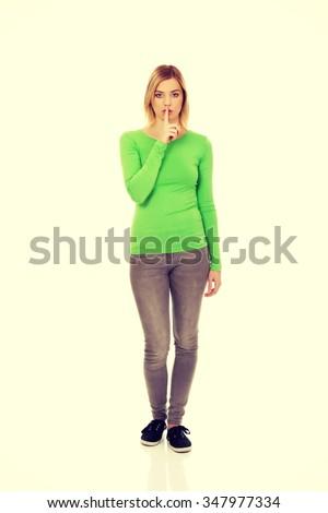 Caucasian woman making hush gesture. - stock photo
