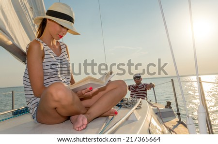 Caucasian woman reading a book at summer - stock photo