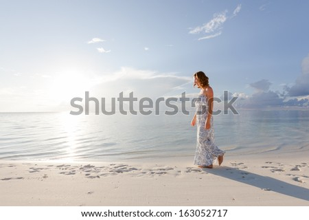 Caucasian woman rests at beautiful seashore