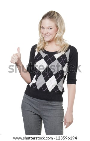 Caucasian woman showing a thumbs up - stock photo